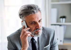 Job age discrimination: mature aged worker receiving rejection call