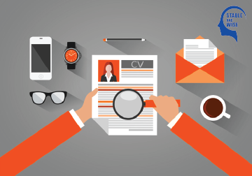 resume tips: resume and magnifying glass