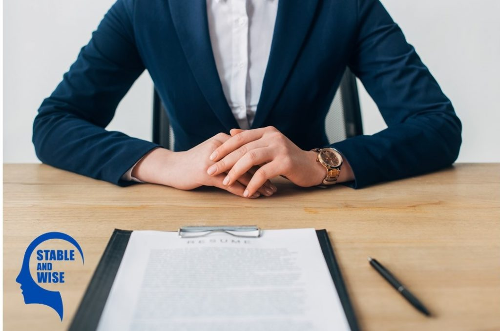 Dealing with recruiters: a woman presenting her resume to a recruiter