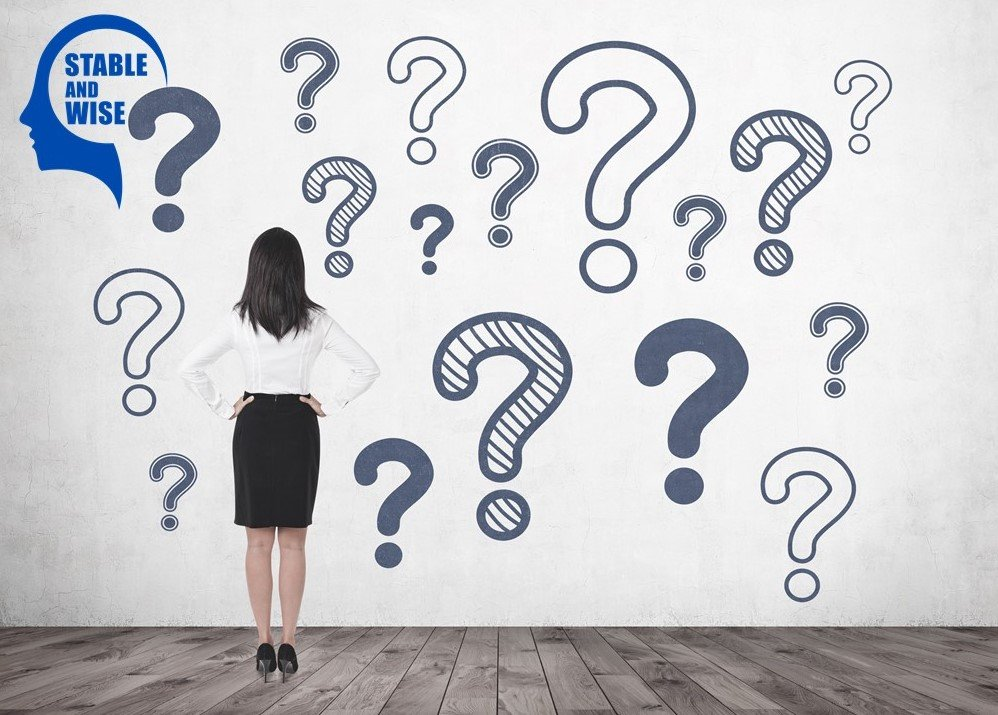 Ageism; Lady standing in front of a wall of questions