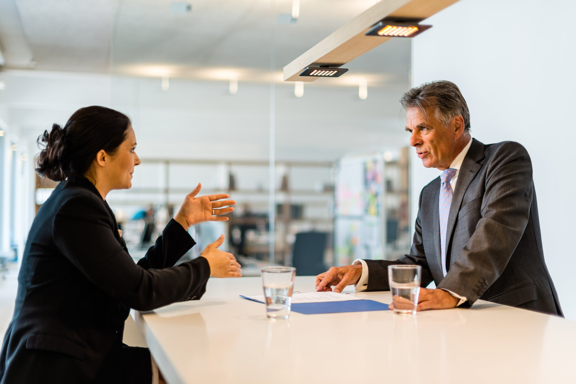 Resume Rules: Young interviewer interviewing an older man