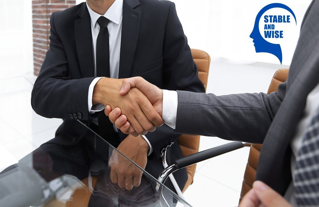 Jobs for over 50s; two workers shaking hands