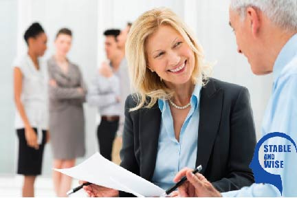 Job search - Middle aged woman smiling at a man at a job interview
