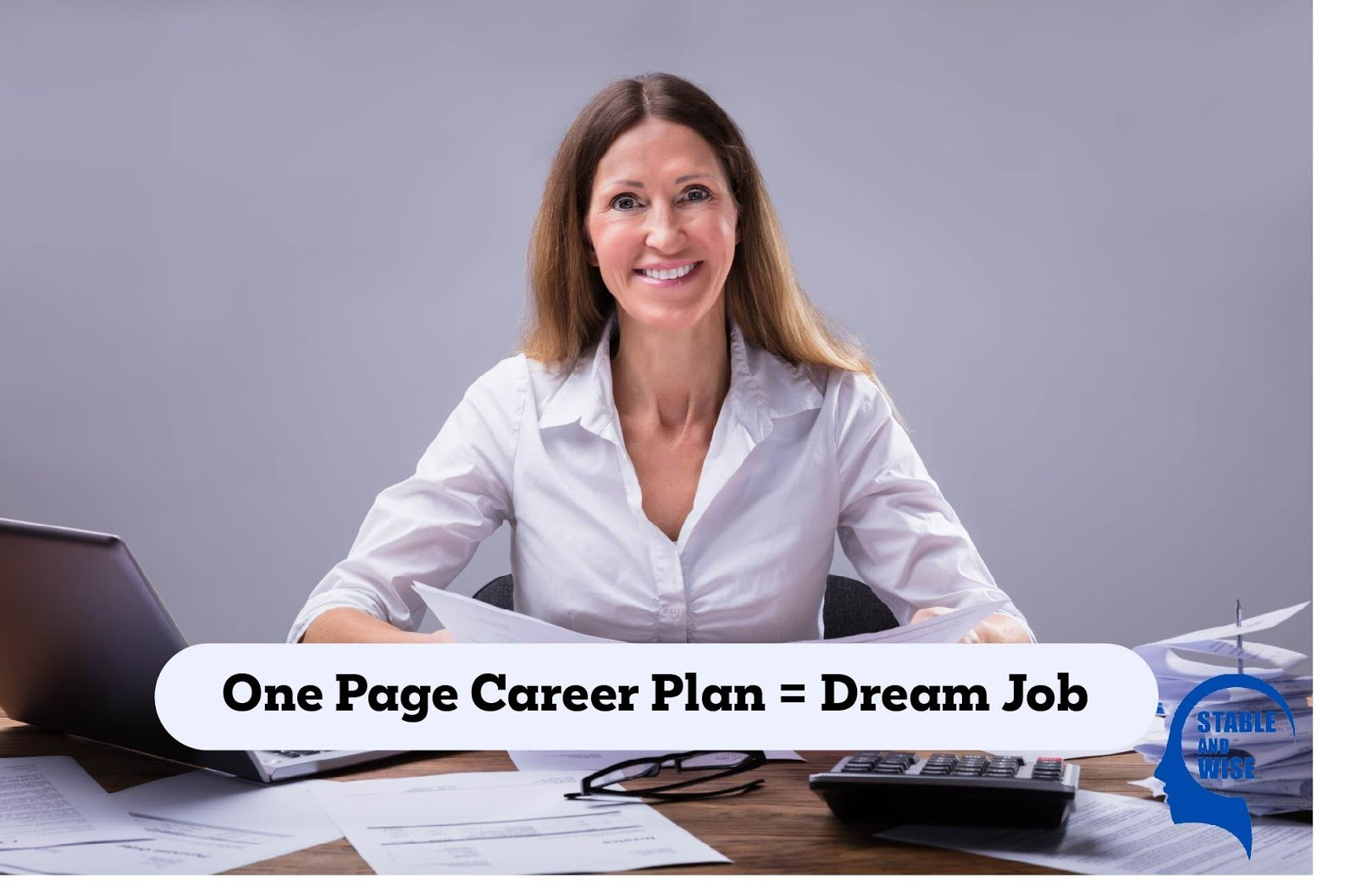 Dream Job: A mature woman sitting at a desk clearly has her dream job!