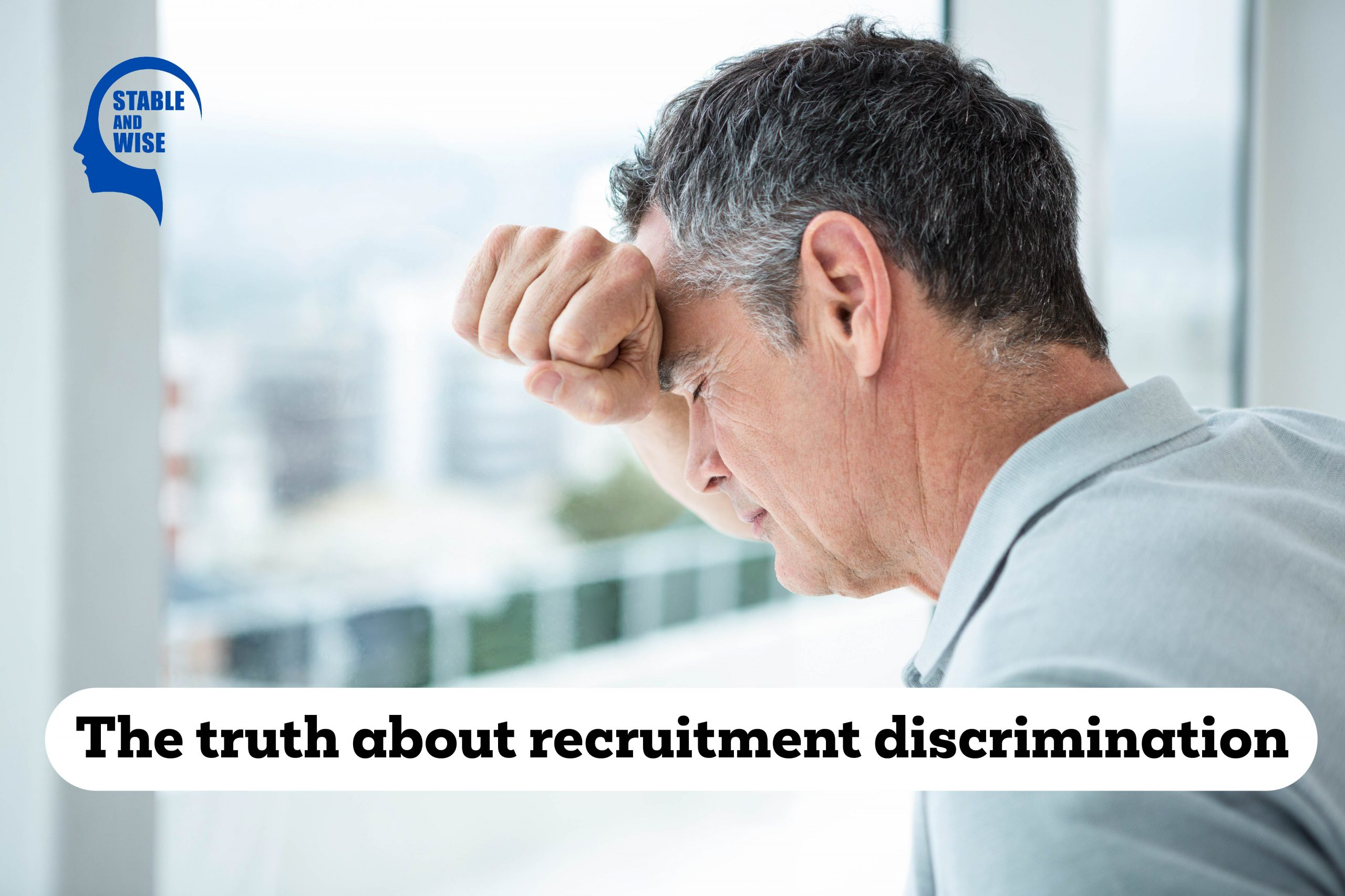 Recruitment discrimination; a man leaning against a window
