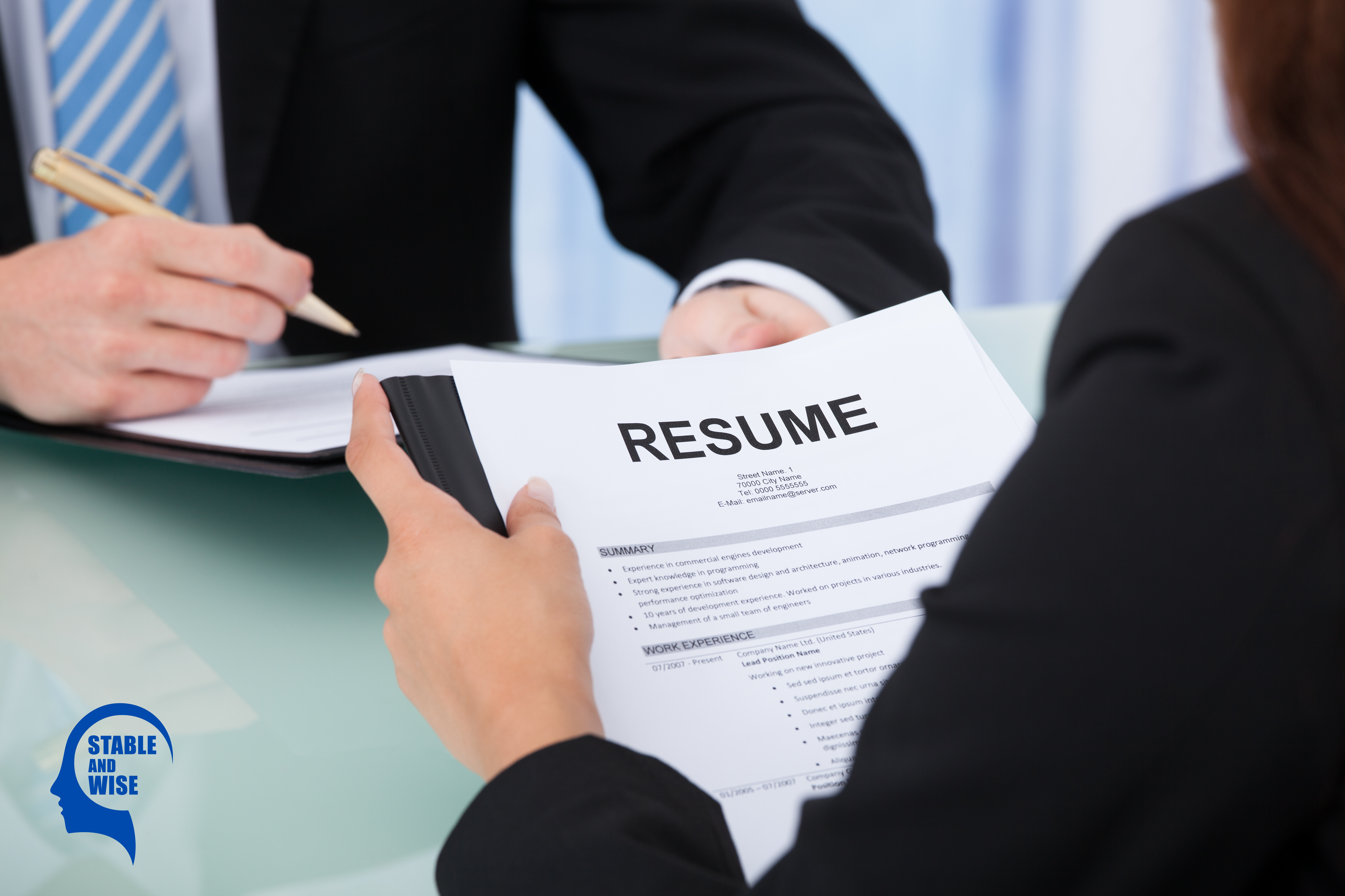 Resume Guide: Candidate holding their resume at interview